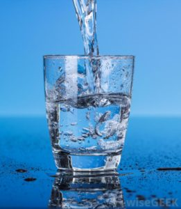 water-into-a-glass-blue-background